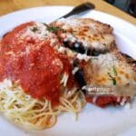 Plate of eggplant parmesan and pasta